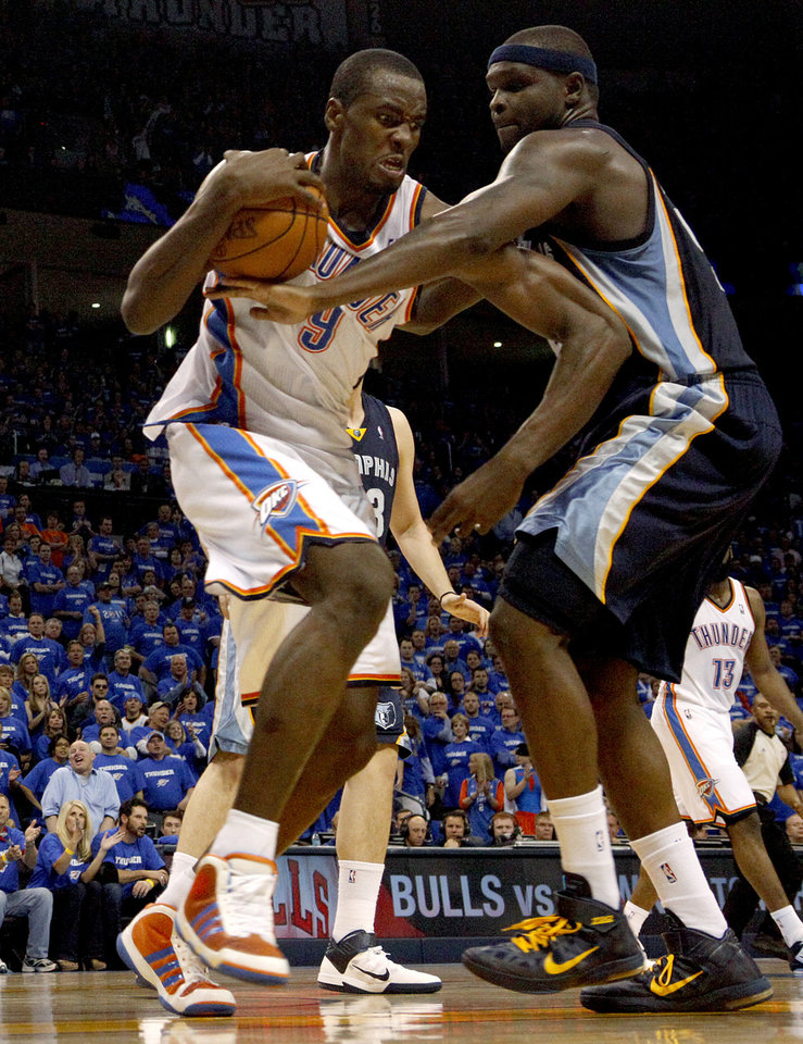 Photo - Oklahoma City's Serge Ibaka (9) fights with Zach Randolph (50) of Memphis for the ball during game two of the Western Conference semifinals between the Memphis Grizzlies and the Oklahoma City Thunder in the NBA basketball playoffs at Oklahoma City Arena in Oklahoma City, Tuesday, May 3, 2011. Photo by Bryan Terry, The Oklahoman