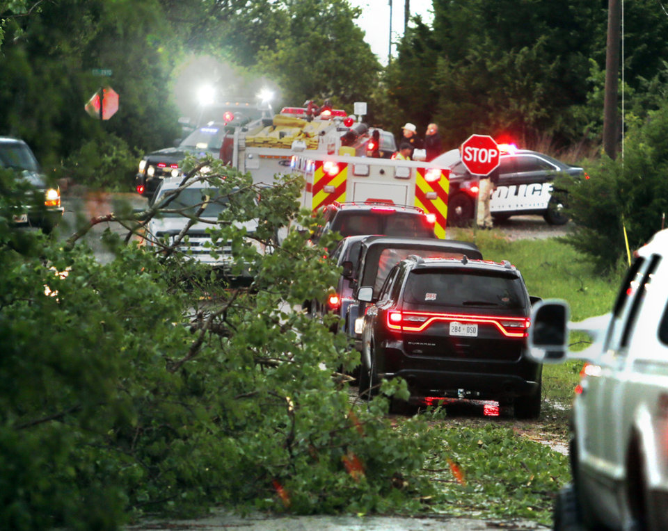 Photo - Motorist navigate fallen trees after a tornado ripped through Bridge Creek, Okla. on Wednesday, May 6, 2015.  Photo by Steve Sisney, The Oklahoman