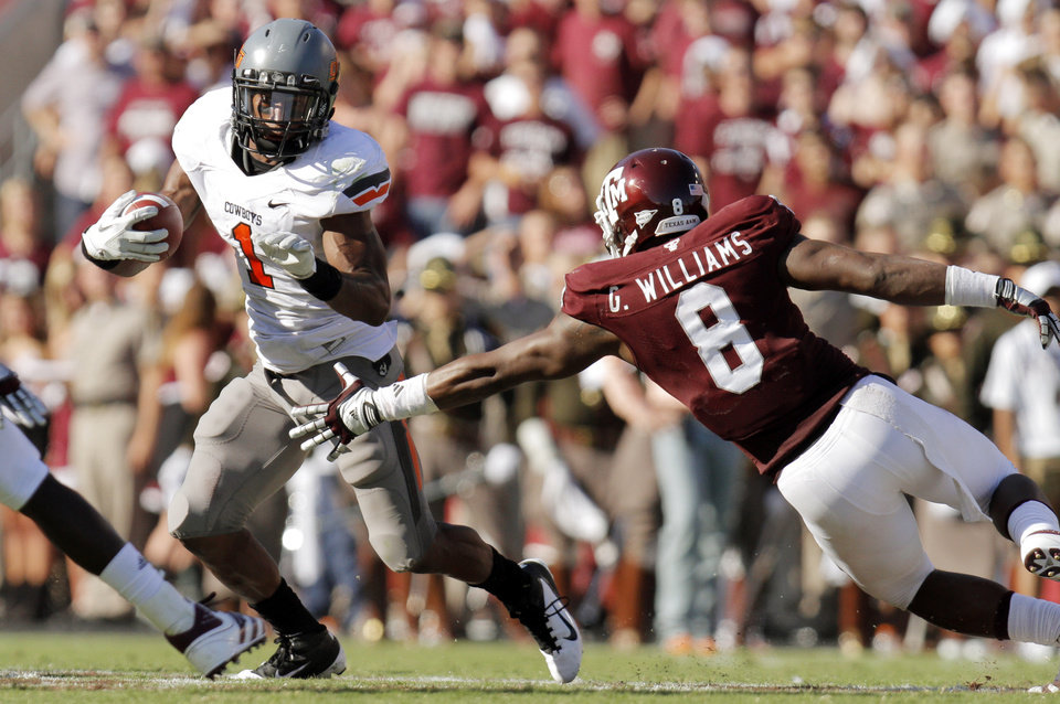 Oklahoma State's Joseph Randle tries to get past Texas A&M's Garrick Williams in the second half of the Cowboys' win on Saturday. Photo by Nate Billings, The Oklahoman