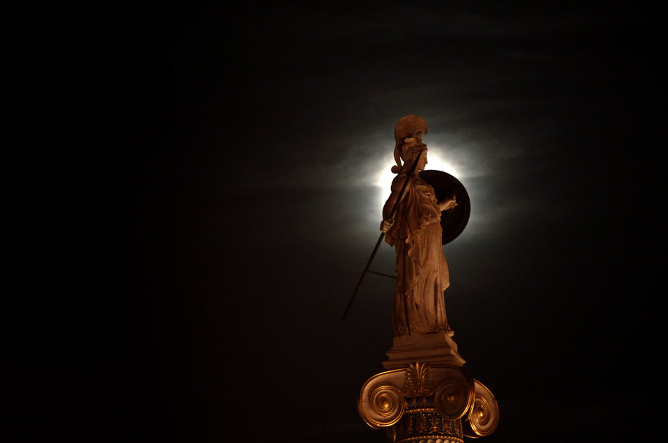 Photo -   A statue of ancient Greek Goddess Athena is highlighted by the moon, in the center of the Greek capital after elections on Sunday, May 6, 2012. Voters in crisis-hit Greece punished parties that have dominated politics for decades, with parties opposed to the country's bailout agreements gaining ground. (AP Photo/Kostas Tsironis)