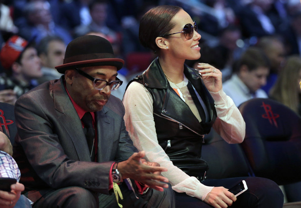 Spike Lee, left and Alicia Keys sit courtside during NBA basketball All-Star Saturday Night, Feb. 16, 2013, in Houston. (AP Photo/Eric Gay)