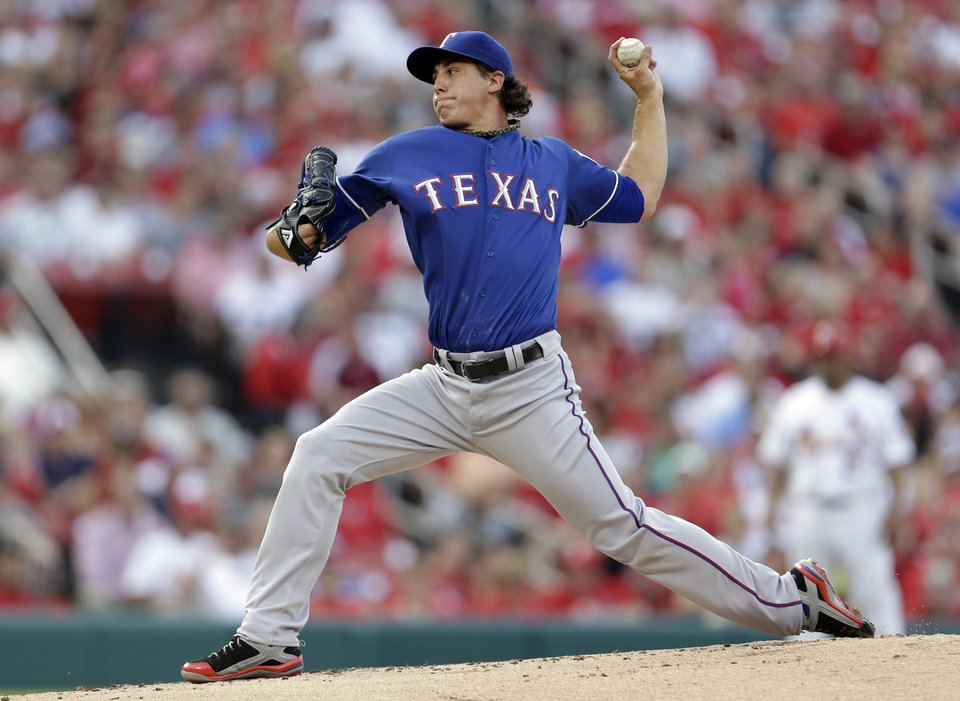 Photo - Texas Rangers starting pitcher Derek Holland throws during the first inning of a baseball game against the St. Louis Cardinals on Friday, June 21, 2013, in St. Louis. (AP Photo/Jeff Roberson)