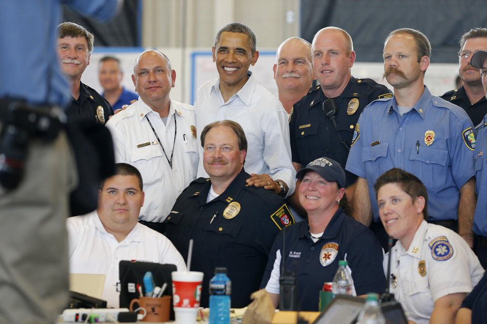 Photo - President Barack Obama poses for a photo with first responders at a Fire Station in Moore, Okla., on Sunday, May 25, 2013. Photo by Bryan Terry The Oklahoman