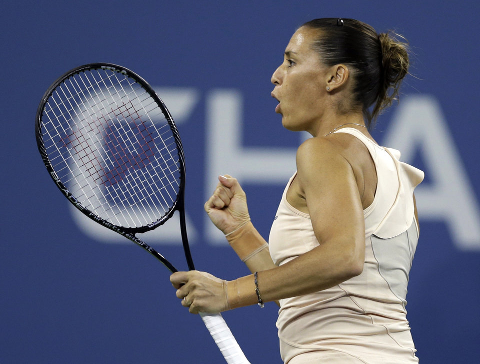 Photo - Flavia Pennetta, of Italy, reacts after breaking the serve of Serena Williams, of the United States, during the quarterfinals of the U.S. Open tennis tournament Wednesday, Sept. 3, 2014, in New York. (AP Photo/Darron Cummings)