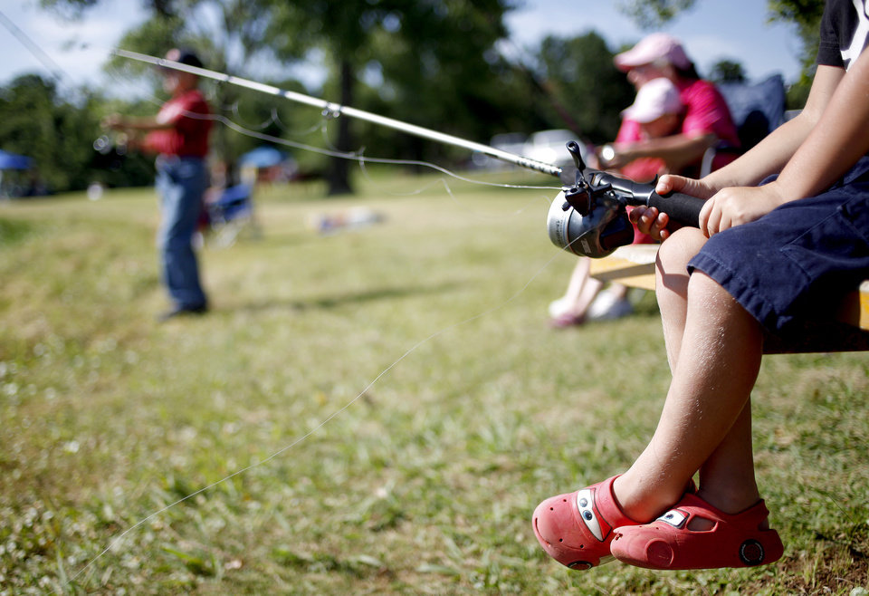 Photo - CHILDREN: James Zumwalt, 4, of Choctaw fishes during a fishing derby for kids in Choctaw, Okla., Saturday, June 20, 2009. Photo by Bryan Terry, The Oklahoman ORG XMIT: KOD