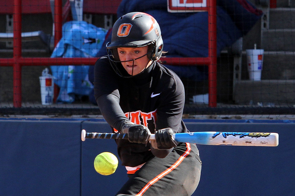 """Oklahoma State Cowgirl Shelby Davis swings at a pitch during the Oklahoma State - Iowa game at """"The Preview"""" Saturday, March 3rd, 2012 at the ASA Hall of Fame Stadium in Oklahoma City. PHOTO BY HUGH SCOTT, FOR THE OKLAHOMAN   ORG XMIT: KOD"""