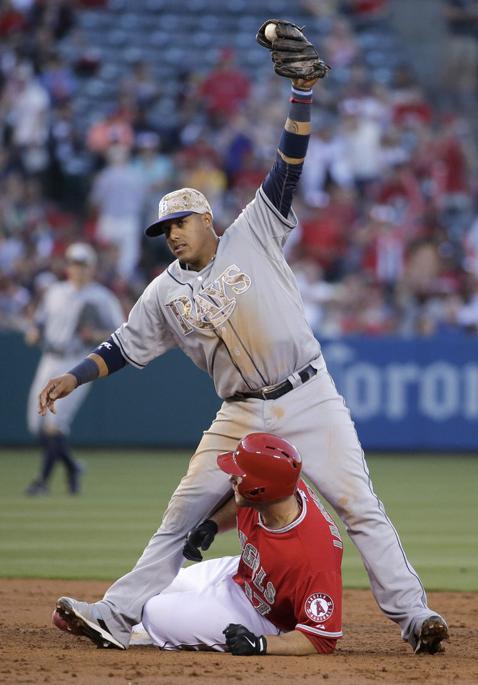 Photo - Los Angeles Angels' Chris Iannetta is safe at second under the tag of Tampa Bay Rays shortstop Yunel Escobar during the third inning of a baseball game in Anaheim, Calif., Saturday, May 17, 2014. (AP Photo/Chris Carlson)