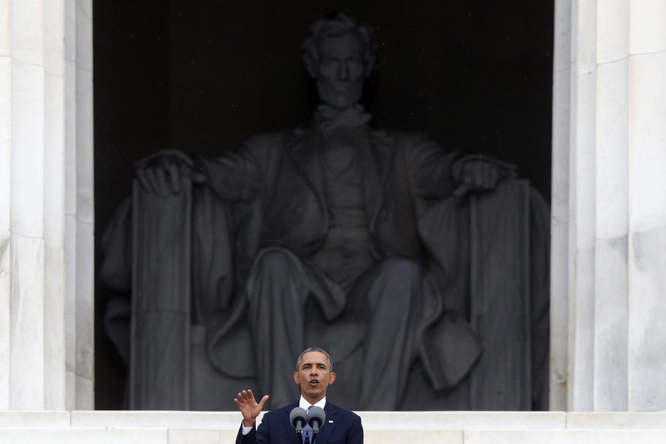 Photo - President Barack Obama speaks at the 50th Anniversary of the March on Washington where Martin Luther King Jr., spoke, Wednesday, Aug. 28, 2013, at the Lincoln Memorial in Washington. (AP Photo/Charles Dharapak)
