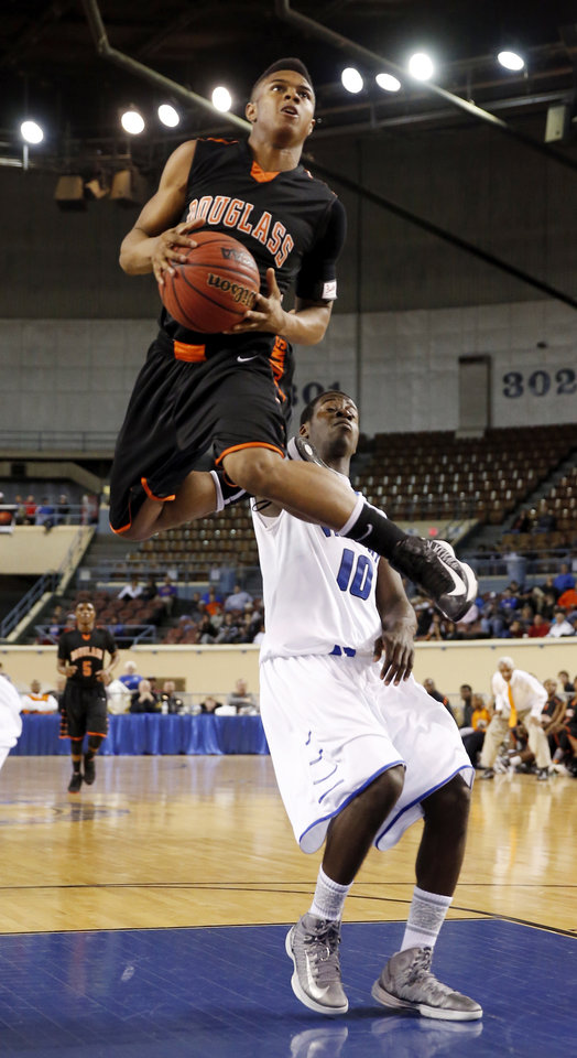 Douglass' Trevon Threatt shoots over Emmanuel Adesokan during the 4A boys semifinal game between the Douglass High School Trojans and Victory Christian's Conquorers at the State Fair Arena on Friday, March 8, 2013 in Oklahoma City, Okla.  Photo by Steve Sisney, The Oklahoman