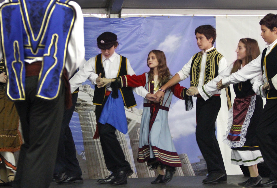 The Agape dancers, a troupe comprised of teens  in the sixth grade through senior year of high school, dress in native attire to perform folk dances of Greece.   Members of St. George's Greek Orthodox Church and community volunteers are sponsoring this years Greek Festival of Oklahoma City. The festival includes food, dancing and an introduction to Greek culture at the church, NW 145 and N. Pennsylvania  on Saturday, Sep. 15, 2012,  Photo by Jim Beckel, The Oklahoman.