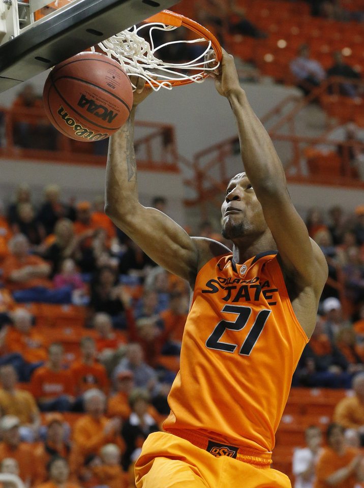 Oklahoma State forward Kamari Murphy dunks against Central Arkansas in the first half of an NCAA college basketball game in Stillwater, Okla., Sunday, Dec. 16, 2012. Oklahoma State won 91-63. (AP Photo/Sue Ogrocki) ORG XMIT: OKSO110