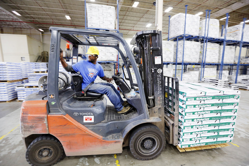 Malarkey Roofing Products fork lift operator Reginald Dotson moves a pallet of shingles in the production plant in Oklahoma City. <strong>Steve Gooch - The Oklahoman</strong>