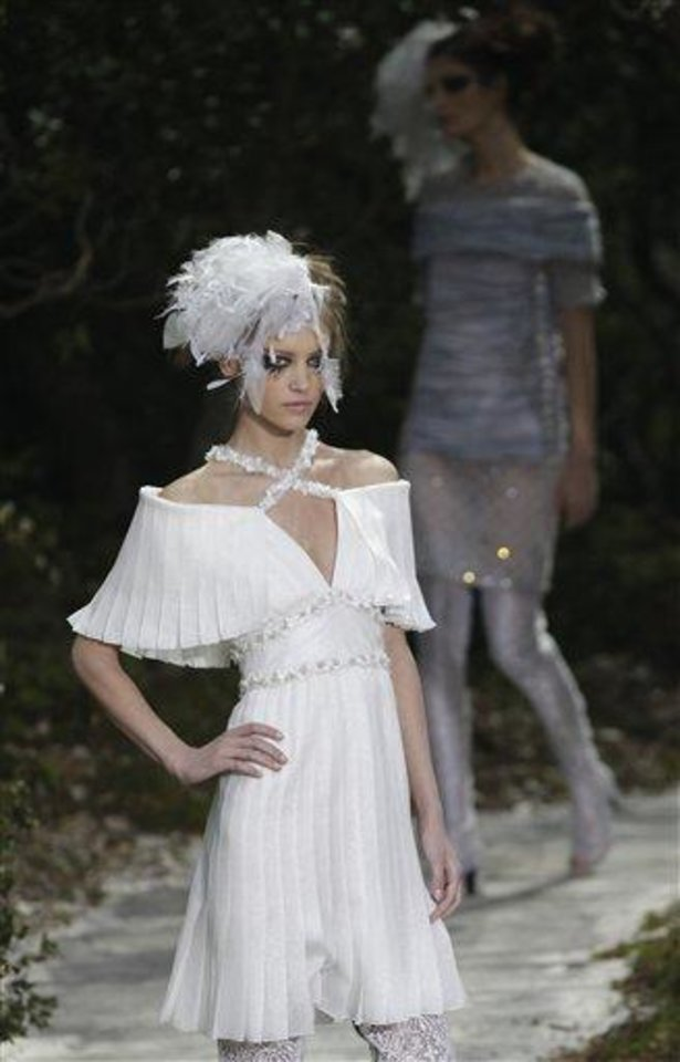 A model presents a creation by German fashion designer Karl Lagerfeld for Chanel's Spring-Summer 2013 Haute Couture fashion collection, presented in Paris, Tuesday, Jan.22, 2013. (AP Photo/Christophe Ena)