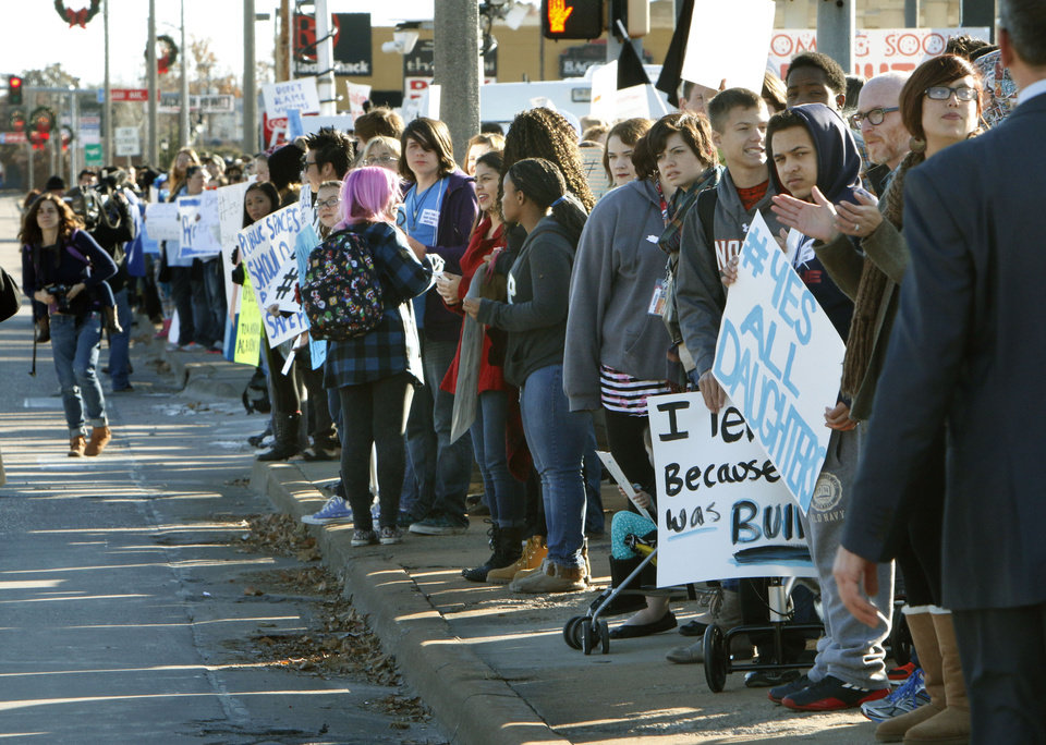 Photo - Norman High School students hold signs during a student-planned walkout to protest bullying and the treatment of sexual assault victims at Norman High School in Norman, OK, Monday, November 24, 2014,  Photo by Paul Hellstern, The Oklahoman