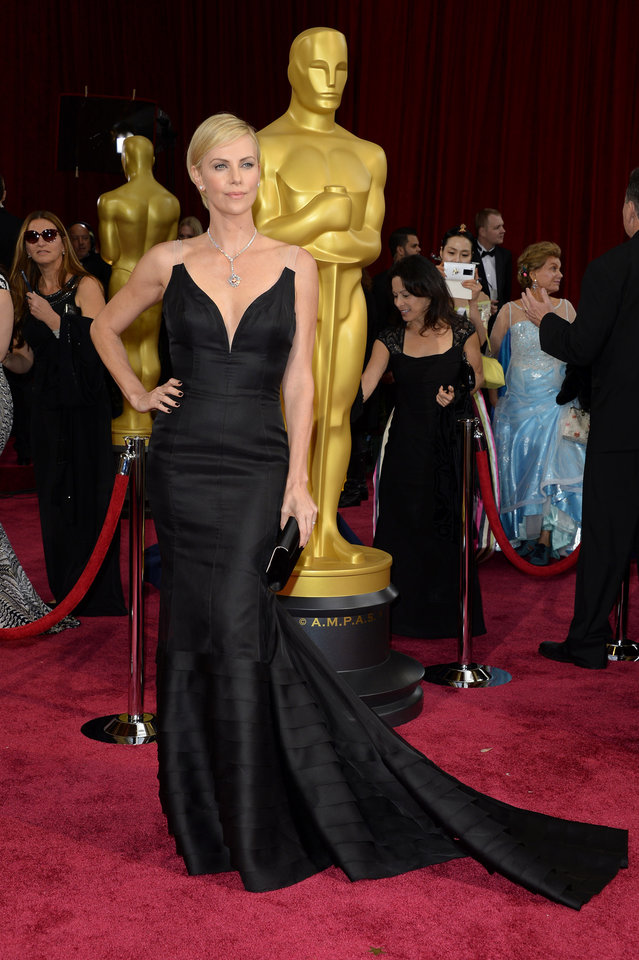 Photo - Charlize Theron arrives at the Oscars on Sunday, March 2, 2014, at the Dolby Theatre in Los Angeles.  (Photo by Dan Steinberg/Invision/AP)
