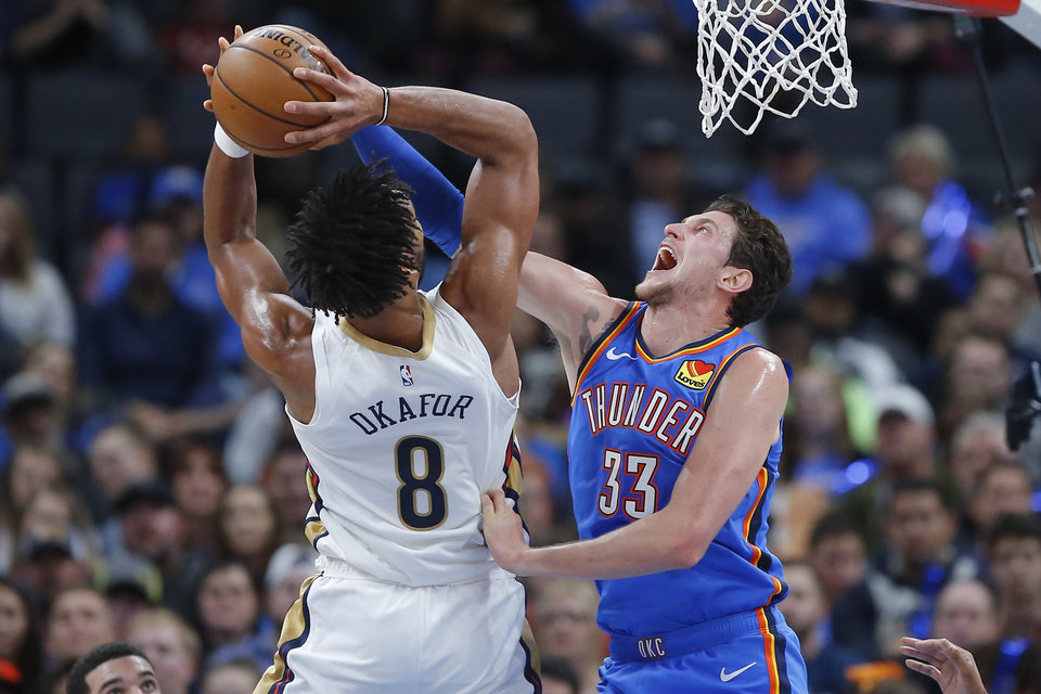 Photo - Oklahoma City's Mike Muscala (33) defends New Orleans' Jahlil Okafor (8) during an NBA basketball game between the Oklahoma City Thunder and the New Orleans Pelicans at Chesapeake Energy Arena in Oklahoma City, Saturday, Nov. 2, 2019. Oklahoma City won 115-104. [Bryan Terry/The Oklahoman]