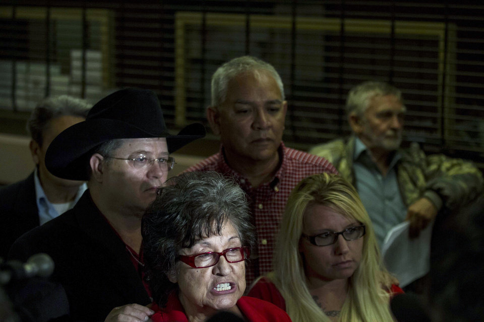 Photo - Activist Nora Tachias-Anaya and family members of people shot by Albuquerque Police officers hold a press conference prior to a city council meeting in Albuquerque, N.M., Thursday, May 8, 2014. The Albuquerque City Council gathered Thursday under new rules and heightened security designed to avoid an angry confrontation like the one that broke out earlier in the week amid community outrage over a spate of deadly police shootings.  (AP Photo/Juan Antonio Labreche)