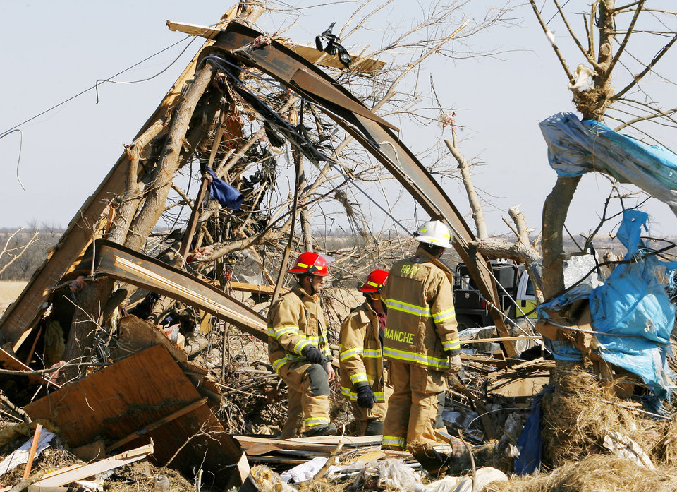 Firemen looking through mobile home debris for unaccounted persons on Brock Road in Lone Grove, Wednesday, Feb. 11, 2009. The rails in the tree are the base of a mobile home. BY PAUL B. SOUTHERLAND, THE OKLAHOMAN