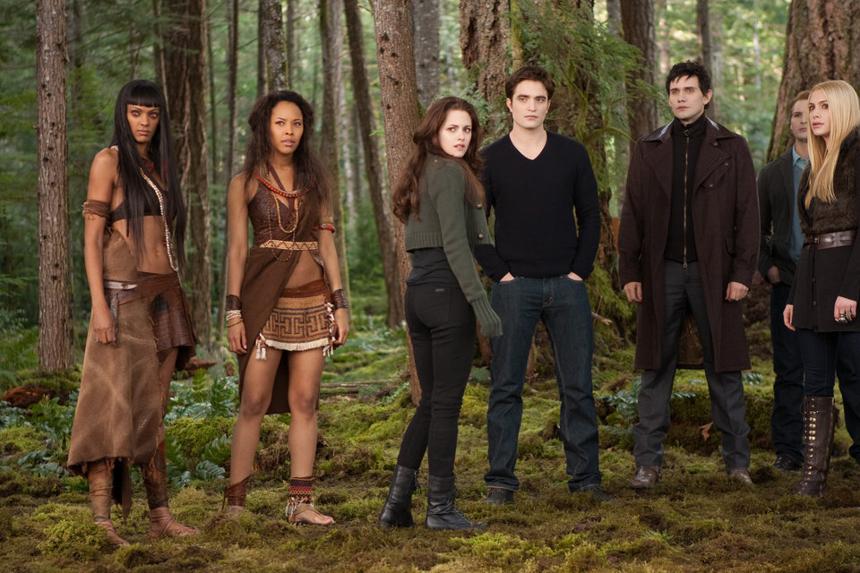 Photo - This undated publicity photo released by Summit Entertainment shows, from left, Judith Shekoni, Tracey Heggins, Kristen Stewart, Robert Pattinson, Christian Camargo, Peter Facinelli and Casey LaBow in a scene from the film,