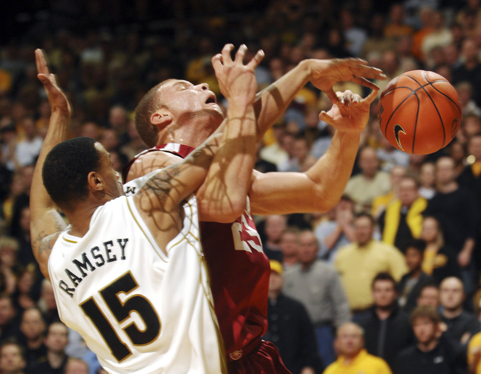 Photo - UNIVERSITY OF OKLAHOMA, OU:   Oklahoma's Blake Griffin, right, is fouled by Missouri's Keith Ramsey, left, as he shoots during the first half of an NCAA college basketball game Wednesday, March 4, 2009, in Columbia, Mo. (AP Photo/L.G. Patterson) ORG XMIT: MOLG101