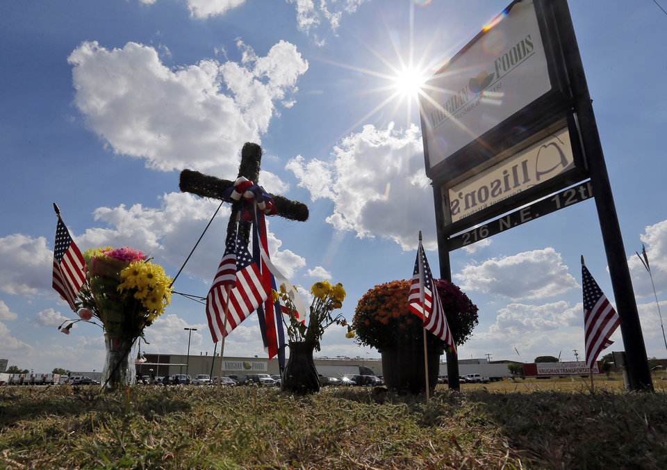 Photo - A memorial stands Monday in front of Vaughan Foods in Moore — a tribute to a woman who was beheaded at the plant last week .  Photo by Nate Billings, The Oklahoman  NATE BILLINGS -  NATE BILLINGS