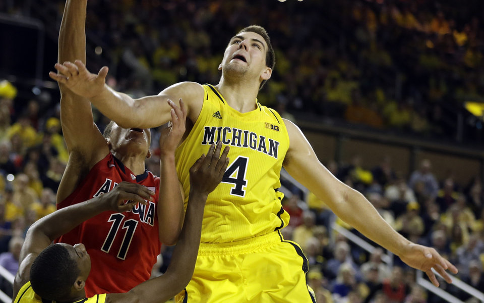 Photo - Michigan forward Mitch McGary (4) waits for the rebound during the second half of an NCAA college basketball game against Arizona in Ann Arbor, Mich., Saturday, Dec. 14, 2013. (AP Photo/Carlos Osorio)