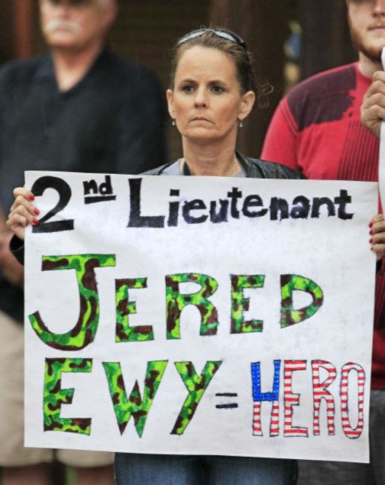 Photo - Stacey Whisenhunt holds a sign in support at the funeral for 2nd Lt Jered Ewy, 33, of Edmond, at Henderson Hills Baptist Church.  Whisenhunt's son E4 Aaron Lyles is in Afghanistan now and he ask her to be there in support.  David McDaniel - THE OKLAHOMAN