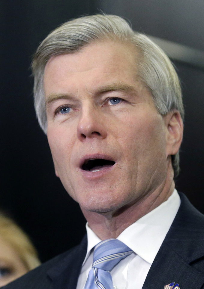 Photo - Former Virginia Gov. Bob McDonnell makes a statement during a news conference in Richmond, Va., Tuesday, Jan. 21, 2014. McDonnell and his wife were indicted Tuesday on corruption charges after a monthslong federal investigation into gifts the Republican received from a political donor.  (AP Photo/Steve Helber)