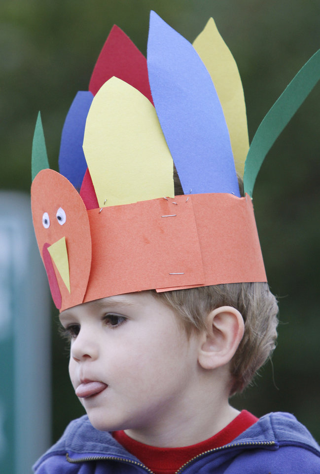 Zach Finley, 3, waits for the start of the Turkey Trot on Thanksgiving morning in Edmond. The annual Turkey Trot is a fundraiser for Turning Point Ministries. PHOTO BY STEVE GOOCH, THE OKLAHOMAN. <strong>Steve Gooch - The Oklahoman</strong>