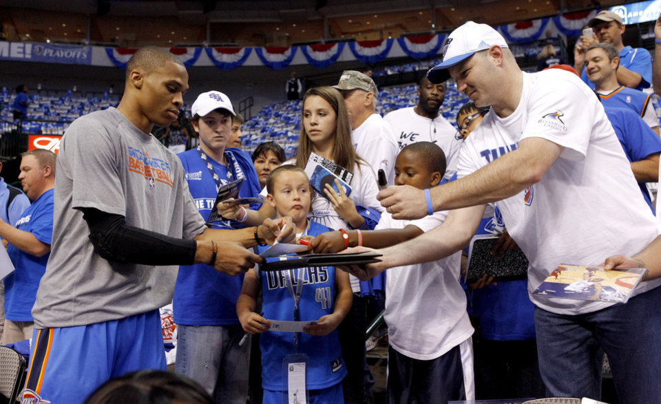 Oklahoma City\'s Russell Westbrook signs autographs before game 2 of the Western Conference Finals in the NBA basketball playoffs between the Dallas Mavericks and the Oklahoma City Thunder at American Airlines Center in Dallas, Thursday, May 19, 2011. Photo by Bryan Terry, The Oklahoman ORG XMIT: KOD