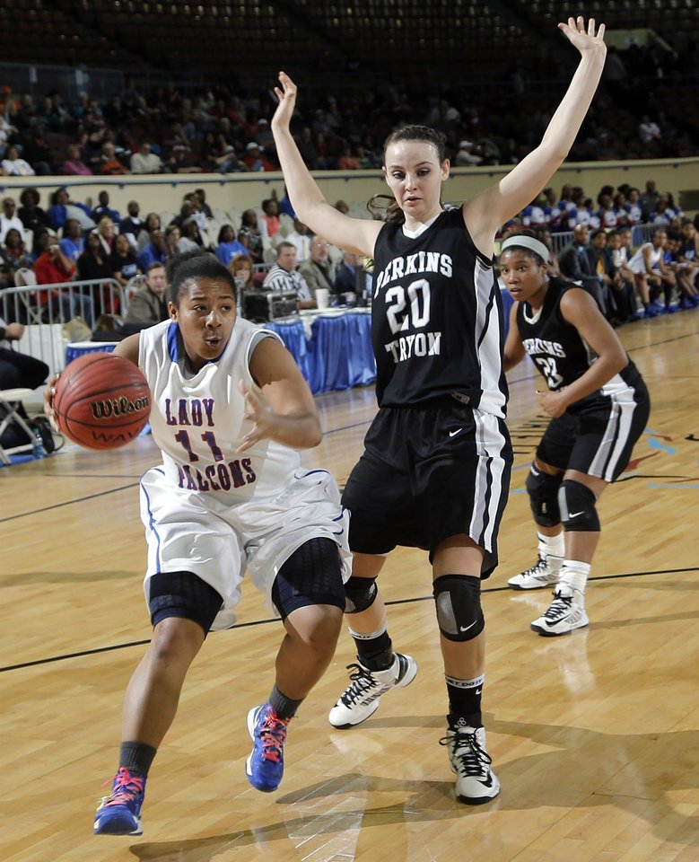 Millwood\'s Da\'Neshia Threatt (11) drives past Perkins\' McKenzie Stanford (20) during the state high school basketball tournament Class 3A girls semifinal game between Millwood High School and Perkins High School at the State Fair Arena on Friday, March 8, 2013, in Oklahoma City, Okla. Photo by Chris Landsberger, The Oklahoman