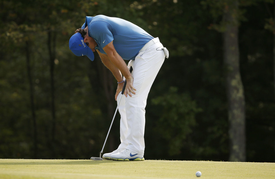 Photo - Rory McIlroy reacts after missing a birdie on the 18th green during the third round of the Deutsche Bank Championship golf tournament in Norton, Mass., Sunday, Aug. 31, 2014. (AP Photo/Michael Dwyer)