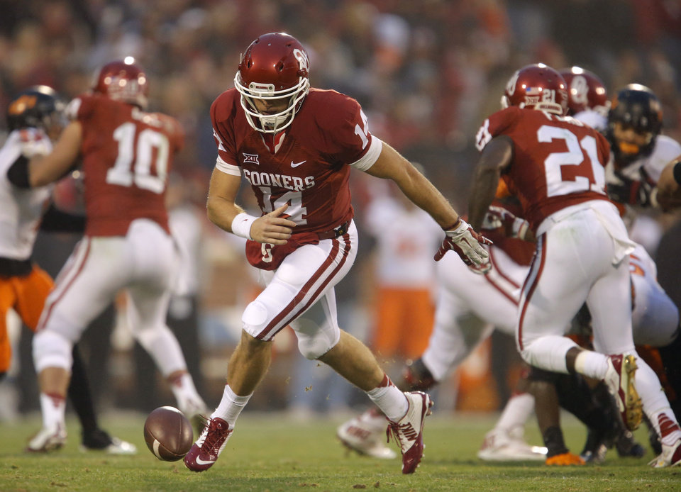 Photo - Oklahoma's Cody Thomas (14) chases down the ball after a fumble during a Bedlam college football game between the University of Oklahoma Sooners (OU) and the Oklahoma State Cowboys (OSU) at Gaylord Family-Oklahoma Memorial Stadium in Norman, Okla., Saturday, Dec. 6, 2014. Photo by Bryan Terry, The Oklahoman