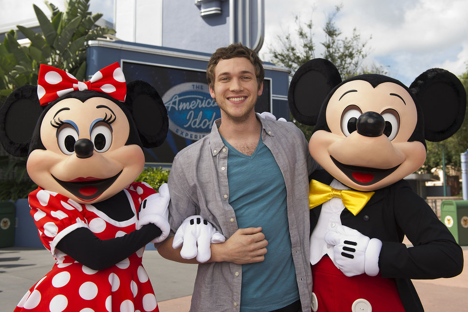 "This image released by Disney shows Phillip Phillips, the latest winner of ""American Idol,"" posing with Minnie Mouse and Mickey Mouse at ""The American Idol Experience"" attraction at Disney's Hollywood Studios in Lake Buena Vista, Fla. on Thursday, Aug. 2, 2012. (AP Photo/Disney, Matt Stroshane)"