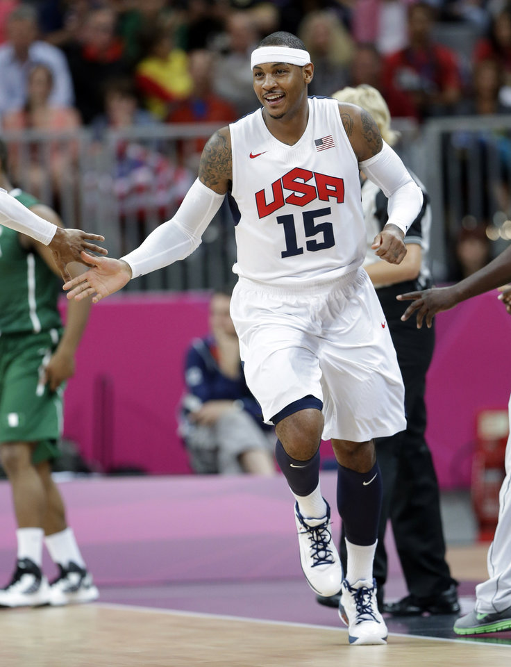 Photo -   USA's Carmelo Anthony celebrates a score against Nigeria during a preliminary men's basketball game at the 2012 Summer Olympics, Thursday, Aug. 2, 2012, in London. (AP Photo/Eric Gay)