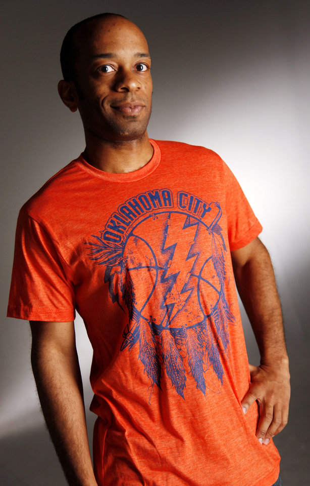 Photo - Cerebellum Thunder T-shirt sold at DNA Galleries. Photo by Doug Hoke, The Oklahoman  DOUG HOKE