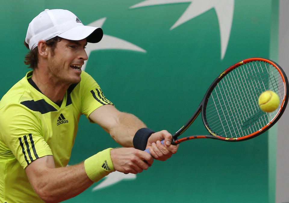 Photo - Britain's Andy Murray returns the ball to Australia's Marinko Matosevic during their second round match of  the French Open tennis tournament at the Roland Garros stadium, in Paris, France, Thursday, May 29, 2014. (AP Photo/Michel Spingler)
