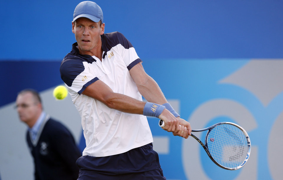 Photo - Czech Tomas Berdych in action against Australian James Duckworth at the Queen's Club grass-court tournament in  London Tuesday June 10, 2014. (AP Photo / Jonathan Brady, PA) UNITED KINGDOM OUT - NO SALES - NO ARCHIVE