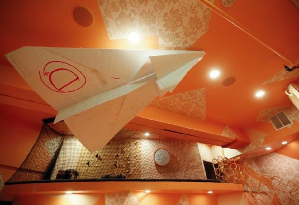 Photo -  A giant paper airplane is one of the new additions to the art attraction