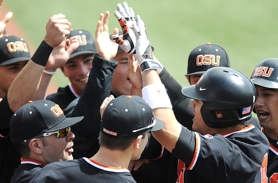Photo - Oregon State's Michael Conforto celebrates a first-inning home run with teammates during an NCAA college baseball game on Sunday, April 27, 2014, in Corvallis, Ore. (AP Photo/Corvallis Gazette-Times, Jesse Skoubo) NO SALES; MAGAZINES OUT