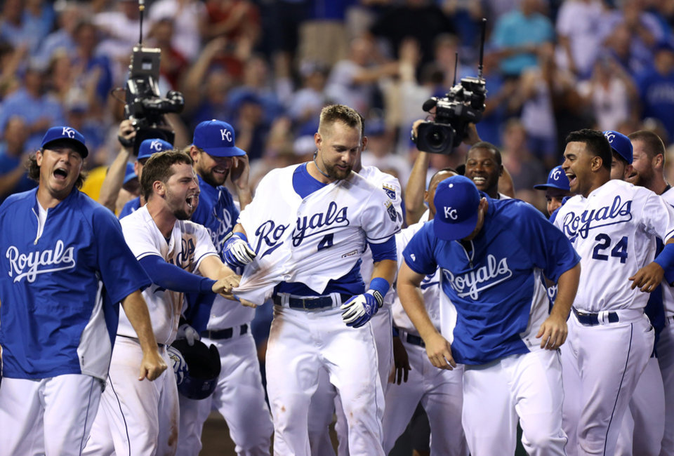 Photo - ADVANCE FOR WEEKEND EDITIONS, AUG. 30-31 - FILE - In this Aug. 26, 2014, file photo, Kansas City Royals' Alex Gordon (4) celebrates with teammates after hitting a two-run walk-off home run during a baseball game against the Minnesota Twins  in Kansas City, Mo. The recipe for small-market success goes something like this: Develop your own talent, succeed with a couple of reclamation projects, find a few diamonds in the rough and make one or two big trades to put your over the top. The Royals have followed that process exactly, and that's why the franchise is staring down its first playoff appearance in nearly 30 years. (AP Photo/Ed Zurga, File)