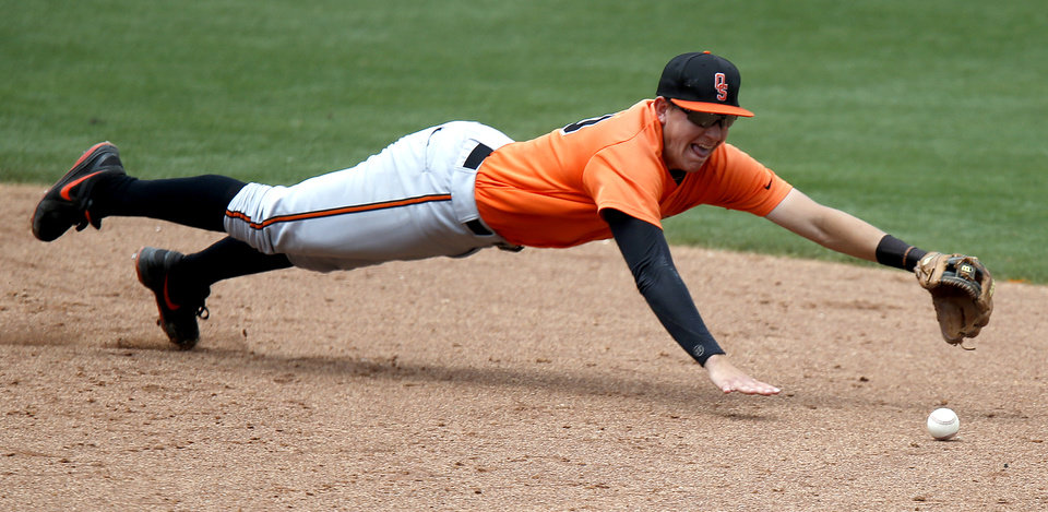 Oklahoma State\'s Craig McConaughy attempts to dive for a ball during the Bedlam baseball game between the University of Oklahoma and Oklahoma State University at the Chickasaw Bricktown Ballpark in Oklahoma CIty, Sunday, May 12, 2013. Photo by Sarah Phipps, The Oklahoman