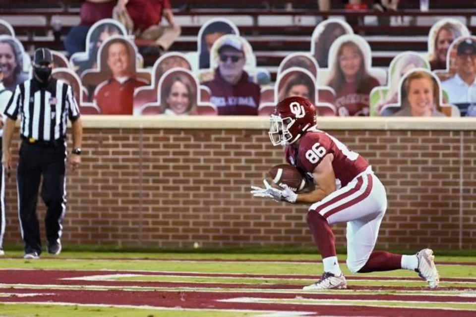 Photo -  Oklahoma wide receiver Finn Corwin (86) catches a pass in the end zone for a touchdown in the second half of an NCAA college football game against Missouri State, Saturday, Sept. 12, 2020, in Norman, Okla. (AP Photo/Sue Ogrocki, Pool)