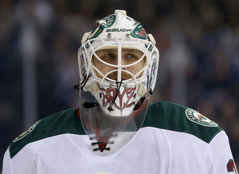 Photo - Minnesota Wild's Ilya Bryzgalov (30) takes a breather during a commercial break while playing against the Winnipeg Jets during second period NHL hockey action in Winnipeg,  Manitoba, Monday, April 7, 2014. (AP Photo/The Canadian Press, Trevor Hagan)
