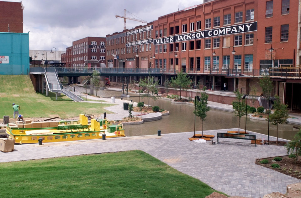 Photo - Horizontal view of the portion of the MAPS canal just west of the Bricktown Ballpark looking between Mickey Mantle Drive and California. Note two canal boats at lower left.