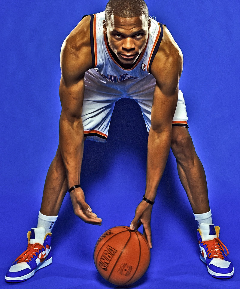 Photo - OKLAHOMA CITY THUNDER NBA BASKETBALL TEAM: Russell Westbrook during Thunder Media Day photos on Monday, Oct. 1, 2012, in Oklahoma City, Oklahoma.  Photo by Chris Landsberger, The Oklahoman