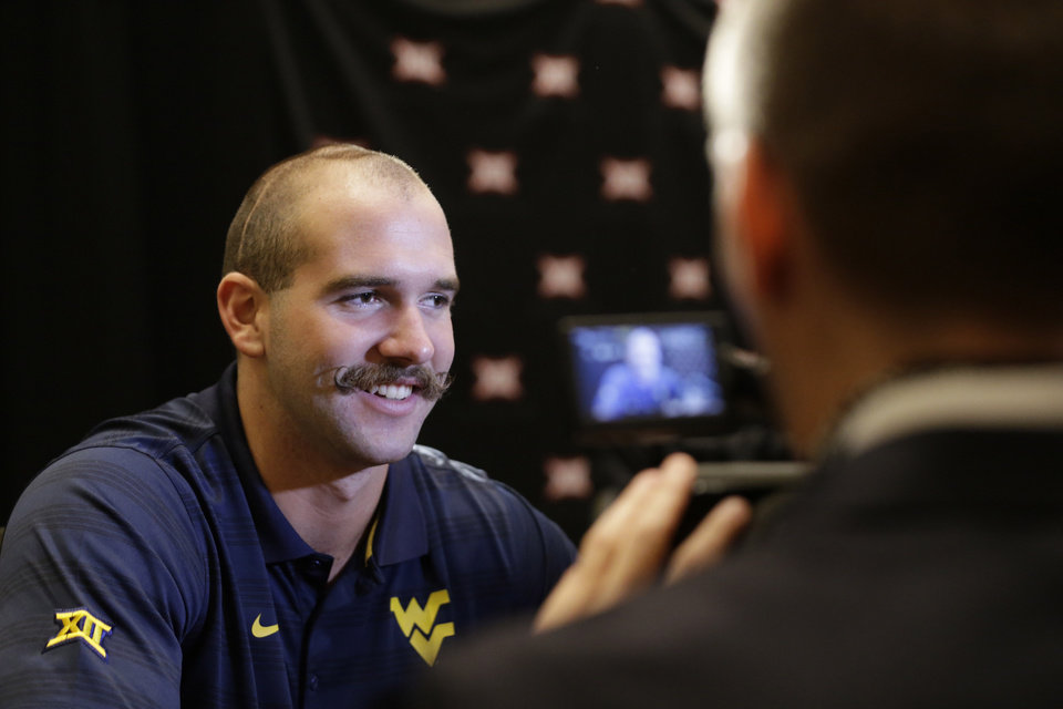 Photo - West Virginia punter Nick O'Toole smiles as he speaks reporters during the NCAA college Big 12 Conference football media days in Dallas, Tuesday, July 22, 2014. (AP Photo)