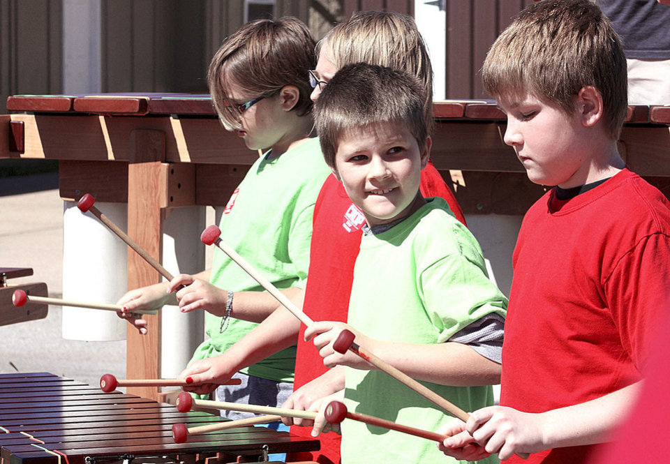 Photo - Children play marimbas at the annual CROP Walk to Stop Hunger. PHOTO BY LYNETTE LOBBAN, FOR THE OKLAHOMAN