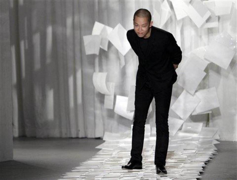 FILE - In this Sept. 9, 2011 file photo, designer Jason Wu takes a bow after presenting his Spring 2012 collection during Fashion Week in New York. Judges in his native Taiwan seem unimpressed that Wu has designed two inaugural gowns for U.S. first lady Michelle Obama. Taiwan\'s Intellectual Property Court ruled Monday, Jan. 21, 2013 that Wu\'s new label