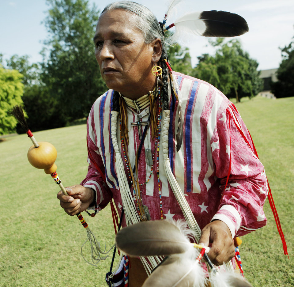 Photo - Albert GreyEagle, a member of the Sioux and Cheyenne tribes, dances at powwow held at St. Gregory's Abbey in Shawnee on July 14, 2013 for mass before the celebration of a feast day for Saint Kateri Tekakwitha. Tekakwitha is the first native American canonized by the Roman Catholic church in October 2012. Photo by KT KING, The Oklahoman
